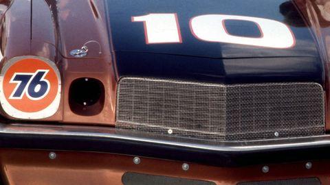 Automotive exterior, Grille, Logo, Bumper, Hood, Symbol, Sign, Classic car, Kit car,