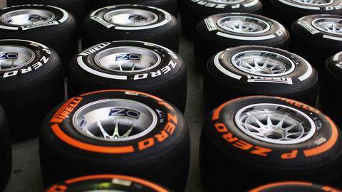 Automotive tire, Orange, Rim, Amber, Font, Light, Logo, Automotive wheel system, Synthetic rubber, Carbon,