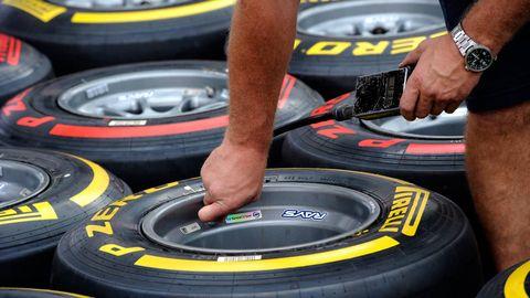 Automotive tire, Yellow, Wrist, Synthetic rubber, Automotive wheel system, Rim, Tread, Elbow, Watch, Auto part,