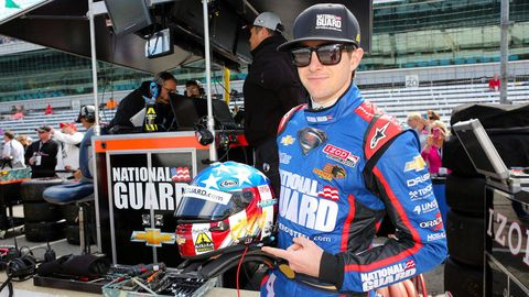 Eyewear, Sunglasses, Cap, Logo, Racing, Motorcycle helmet, Goggles, Baseball cap, Motorsport, Auto racing,