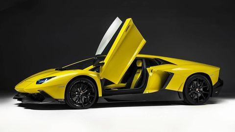 Motor vehicle, Automotive design, Yellow, Vehicle, Automotive exterior, Rim, Vehicle door, Supercar, Car, Automotive wheel system,