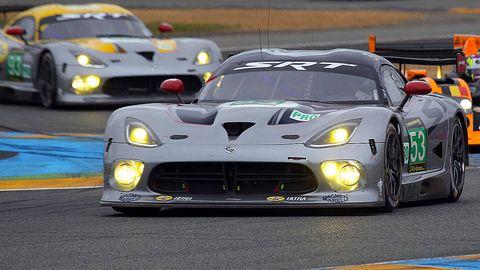 Tire, Automotive design, Vehicle, Land vehicle, Sports car racing, Car, Race track, Performance car, Sports car, Headlamp,