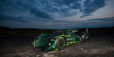 Tire, Automotive design, Green, Automotive tire, Motorsport, Plain, Racing, Race car, Automotive wheel system, Auto part,