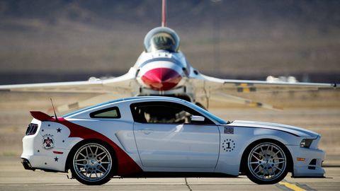 Tire, Wheel, Automotive design, Blue, Automotive tire, Vehicle, Airplane, Performance car, Rim, Alloy wheel,