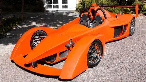 Automotive design, Orange, Rim, Fender, Alloy wheel, Automotive wheel system, Spoke, Vehicle door, Auto part, Hood,