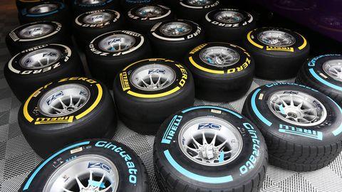 Automotive tire, Automotive wheel system, Rim, Synthetic rubber, Logo, Tread, Alloy wheel, Symbol, Formula one tyres, Circle,