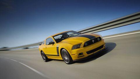 Motor vehicle, Mode of transport, Automotive design, Transport, Yellow, Road, Hood, Infrastructure, Automotive tire, Rim,