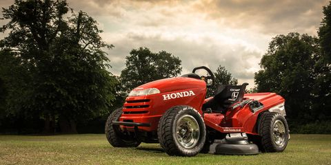 Tire, Wheel, Grass, Automotive design, Agricultural machinery, Automotive tire, Fender, Tread, Machine, Auto part,
