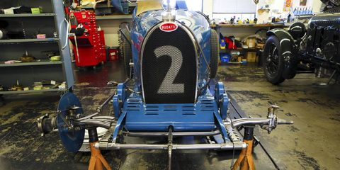Automotive design, Automotive tire, Engineering, Machine, Auto part, Electric blue, Classic, Cobalt blue, Gas, Synthetic rubber,