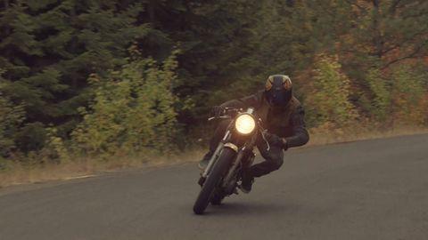 Motorcycle, Mode of transport, Road, Motorcycle helmet, Motorcycling, Automotive design, Automotive tire, Road surface, Helmet, Automotive lighting,