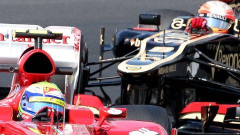 Sport venue, Open-wheel car, Formula one, Race track, Personal protective equipment, Formula racing, Helmet, Motorsport, Automotive tire, Racing,