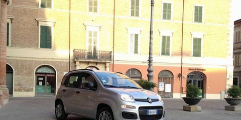 Tire, Motor vehicle, Wheel, Automotive design, Window, Flowerpot, Vehicle, Land vehicle, Car, Rim,