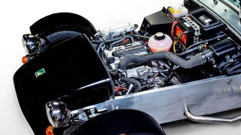 Engine, Motorcycle accessories, Automotive lighting, Automotive engine part, Motorcycle, Carbon, Automotive super charger part, Automotive fuel system, Kit car, Personal luxury car,