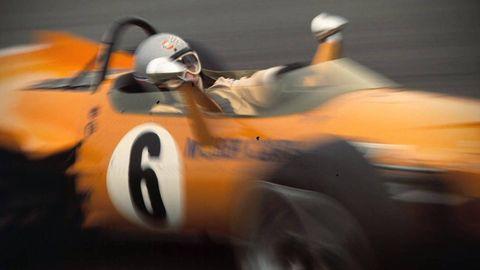 Mode of transport, Automotive design, Automotive tire, Orange, Race car, Logo, Automotive wheel system, Motorsport, Auto part, Racing,