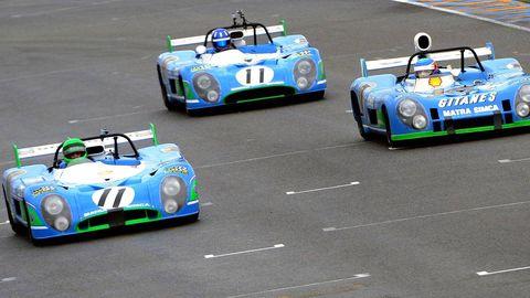 Mode of transport, Automotive design, Green, Vehicle, Land vehicle, Car, Race car, Headlamp, Sports car, Logo,
