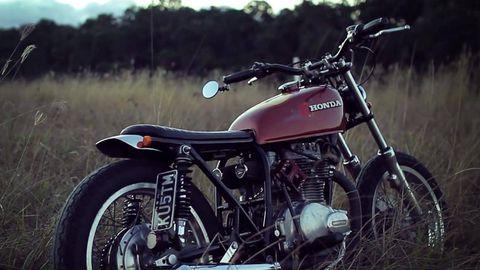 Motorcycle, Tire, Wheel, Fuel tank, Automotive tire, Transport, Spoke, Rim, Fender, Automotive fuel system,