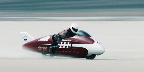 Watercraft, Carmine, Logo, Airplane, Aircraft, Symbol, Water transportation, Brand, Aviation, Graphics,