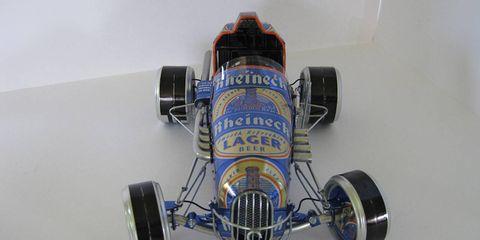 Tire, Automotive tire, Automotive design, Blue, Open-wheel car, Automotive wheel system, Rim, Car, Automotive exterior, Formula one,