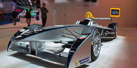 Automotive design, Mode of transport, Automotive tire, Logo, Sports car, Auto show, Race car, Automotive wheel system, Alloy wheel, Motorsport,