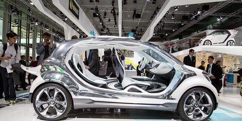 Motor vehicle, Automotive design, Product, Vehicle, Car, Auto show, Concept car, Exhibition, Vehicle door, Alloy wheel,