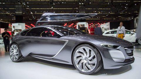 Tire, Wheel, Automotive design, Vehicle, Event, Land vehicle, Car, Grille, Exhibition, Auto show,
