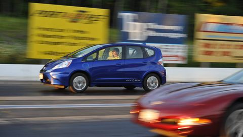 For The First 60 Feet And Beyond Mike Kamm S Brand New All Electric Honda Fit Ev Is Pulling Away From A C5 Corvette Convertible In Near Lane