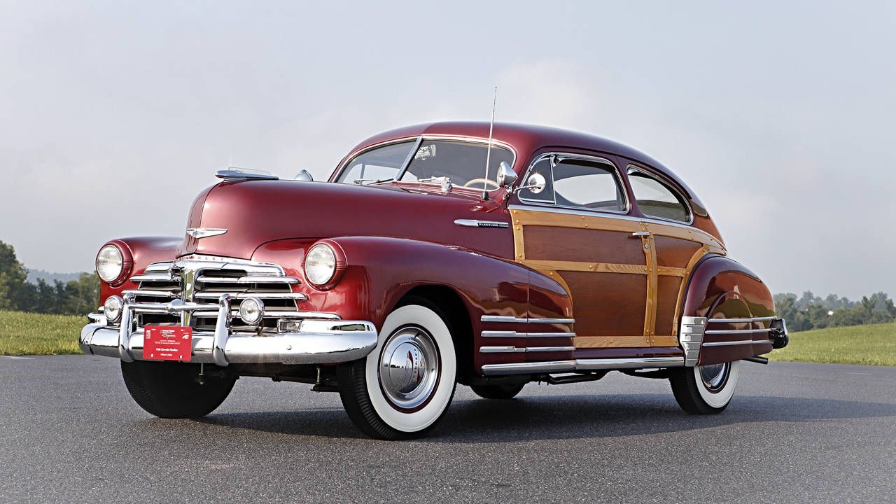 Buy this 1948 Chevrolet Fleetline Aerosedan Coupe and an extra-classy suit