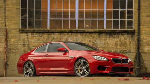 Wheel, Automotive design, Vehicle, Alloy wheel, Rim, Car, Performance car, Red, Personal luxury car, Grille,