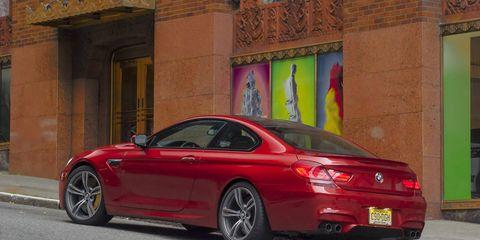 Tire, Wheel, Automotive design, Vehicle, Rim, Red, Alloy wheel, Automotive tail & brake light, Car, Spoke,