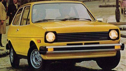 Automotive design, Vehicle, Land vehicle, Yellow, Car, Rim, Hood, Fender, Vehicle door, Automotive parking light,
