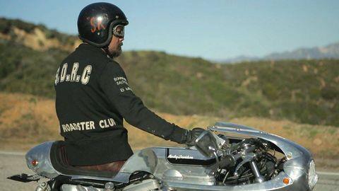 Motorcycle, Vehicle, Automotive design, Motorcycle helmet, Helmet, Outerwear, Personal protective equipment, Motorcycling, Fuel tank, Fender,