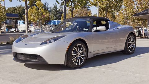 A Pre Owned Tesla Roadster And Handheld Hydrogen Charging Station