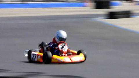 Automotive design, Helmet, Go-kart, Sport venue, Sports gear, Kart racing, Race track, Competition event, Racing, Personal protective equipment,