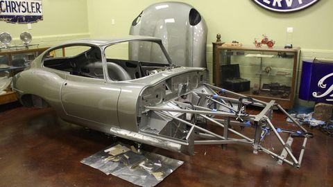 Automotive design, Aerospace engineering, Logo, Machine, Windshield, Space, Classic car, Aircraft, Engineering, Wall clock,