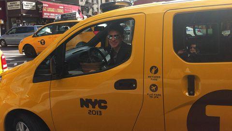 Motor vehicle, Land vehicle, Yellow, Vehicle, Transport, Vehicle door, Car, Sunglasses, Automotive mirror, Rim,