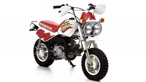 Motorcycle, Tire, Wheel, Fuel tank, Automotive tire, Transport, Automotive design, Rim, Automotive lighting, Spoke,