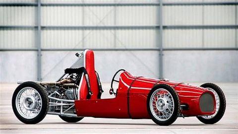 Automotive tire, Automotive design, Open-wheel car, Car, Automotive wheel system, Red, Synthetic rubber, Rim, Race car, Logo,