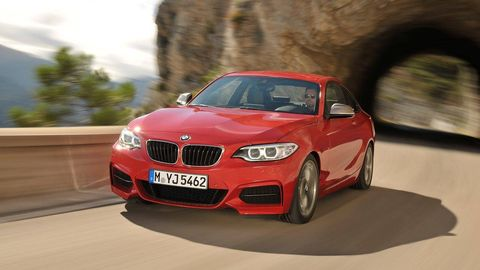 Automotive design, Vehicle, Hood, Automotive mirror, Grille, Automotive lighting, Rim, Car, Red, Performance car,