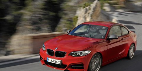 Tire, Automotive design, Vehicle, Hood, Land vehicle, Car, Grille, Red, Performance car, Rim,