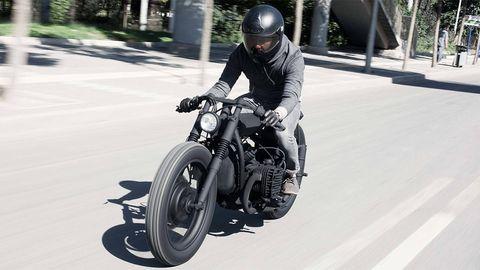 Motorcycle, Motorcycle helmet, Automotive tire, Helmet, Automotive design, Shoe, Motorcycling, Personal protective equipment, Fender, Vehicle brake,