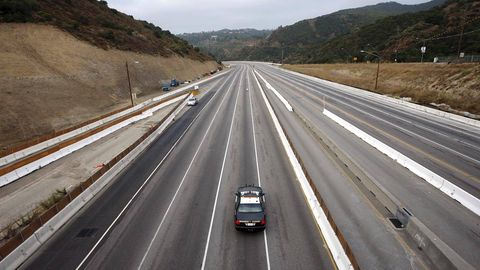 Motor vehicle, Road, Mode of transport, Transport, Road surface, Automotive design, Land vehicle, Automotive exterior, Asphalt, Highway,