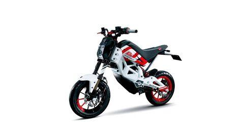 Motorcycle, Rim, Motorcycle racing, Motorcycle accessories, Carbon, Spoke, Vehicle brake, Motorsport, Motocross, Shock absorber,