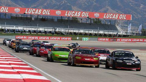 Land vehicle, Vehicle, Automotive parking light, Car, Motorsport, Sport venue, Race track, Touring car racing, Automotive lighting, Sports car racing,