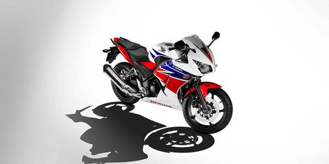 Wheel, Motorcycle, Automotive design, Automotive tire, Automotive wheel system, Motorcycle accessories, Auto part, Motorcycle racing, Motorsport, Graphics,