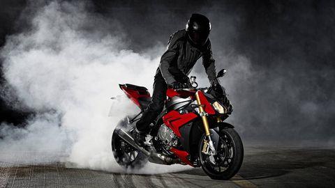 Motorcycle, Tire, Wheel, Automotive design, Automotive tire, Motorcycle helmet, Shoe, Automotive lighting, Land vehicle, Motorsport,