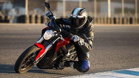Motorcycle, Motorcycle helmet, Automotive design, Automotive tire, Motorcycling, Automotive lighting, Motorcycle racing, Shoe, Helmet, Personal protective equipment,