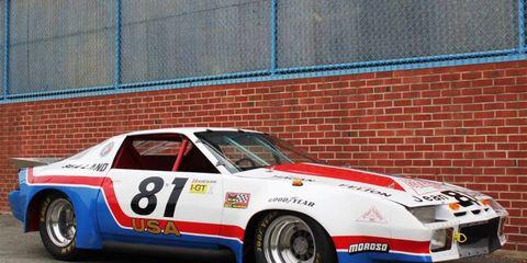 Tire, Wheel, Vehicle, Motorsport, Car, Brick, Automotive exterior, Automotive decal, Race car, Fender,