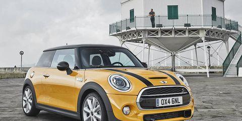 Automotive design, Yellow, Vehicle, Land vehicle, Vehicle door, Car, Grille, Hood, Headlamp, Vehicle registration plate,
