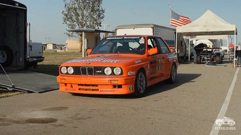 Land vehicle, Vehicle, Car, Flag, Asphalt, Rim, Motorsport, Race car, Automotive parking light, Bumper,