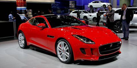 Wheel, Tire, Automotive design, Land vehicle, Vehicle, Event, Car, Performance car, Red, Automotive wheel system,